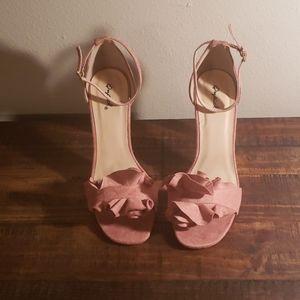 Quipid pink suede heels.
